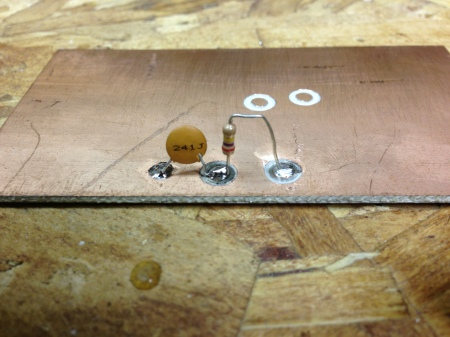 The end result of the hole saw and some mounted components.